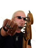 Rock guitarist. With an electric guitar, isolated on white background Stock Image