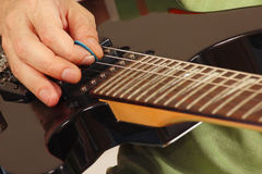 Rock guitarist playing the electric guitar close up Stock Photos