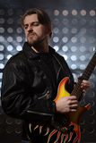Rock guitarist playing electric guitar Royalty Free Stock Photography