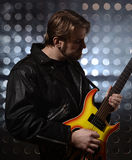 Rock guitarist playing electric guitar Stock Images