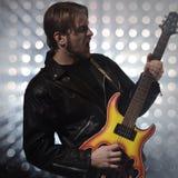 Rock guitarist playing electric guitar Stock Image