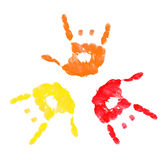 Rock on hand prints. Three colorful hands making a rock on sign Stock Photography