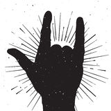 Rock hand sign silhouette, grunge template for your  text Royalty Free Stock Photography