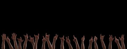 Rock hands in the dark. Many rock hands holding up in the dark on concert stock image