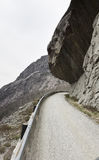 Rock hanging over road Stock Photos