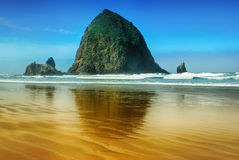 The rock Head of Yaquina on the coast of the Pacific Ocean. Stock Photos