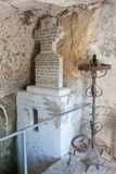 Orthodox stone cross, inside the Rock-hewn Churches of Ivanovo. The Rock-hewn Churches of Ivanovo are a group of monolithic churches, chapels and monasteries royalty free stock photos
