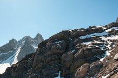 Rock at high mountain range Stock Images