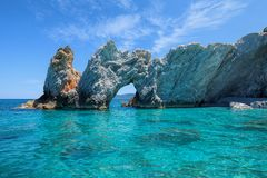 The rock with a hole in Lalaria Beach, Skiathos.  stock photo
