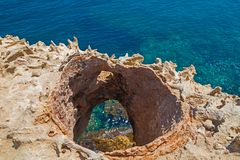 Rock with a hole overlooking the Adriatic sea stock image