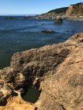 Rock hole overlooking the bay. royalty free stock image