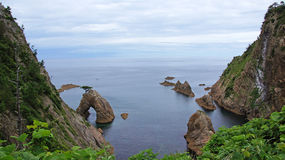 Rock with hole and tree near Tottori in Japan Stock Images