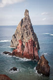 Rock. A huge rock surrounded by the ocean Royalty Free Stock Photography