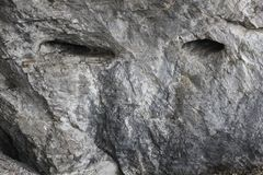 Rock with a human look. Whims nature. royalty free stock photo
