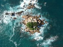 Rock island from Above in Pacific Ocean near Acapulco, Mexico. Rock island in Pacific Ocean waves near Acapulco Bay, Mexico Royalty Free Stock Photo