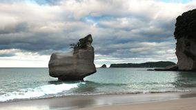 Rock island at cathedral cove. Small rock island at cathedral cove on the north island of new zealand stock video footage