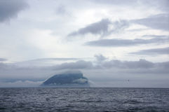 Rock Island in clouds on Faroe Islands Royalty Free Stock Image