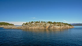 Rock island in a fjord Royalty Free Stock Photo
