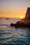 Rock island at golden sunset in Brela Royalty Free Stock Photography