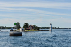 The Rock Island Lighthouse, Thousand Islands. Rock Island Lighthouse State Park,Thousand Islands,New York,USA - August 5, 2013 : The Rock Island Lighthouse on royalty free stock images