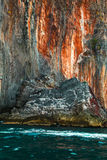 Rock island and red stones on blue tropical sea, Philippines Stock Photography