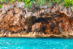 Rock island and red stones on blue tropical sea, PhilippinesBora Royalty Free Stock Photography