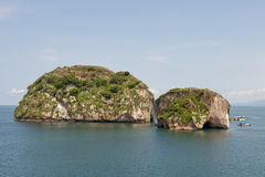 Rock islands in ocean Stock Photos