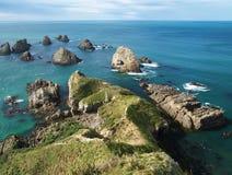 Rock islands in the ocean Stock Photo
