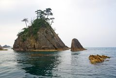 The rock and the islet. This is the rock and the islet in the sea near Tottori, Japan. A famous touristical plase stock images