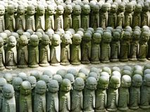 Rock of Japanese Dolls. The Prayerful Rock of Japanese Dolls Stock Images