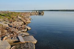 Rock jetty shoreline on Northeast side of Cayuga Lake. Seen from Long Point State Park on a calm summer day you can see all the way down the 40 mile lake Royalty Free Stock Photos