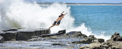Rock Jumping Maloolaba Sunshine Coast Queensland. Royalty Free Stock Image
