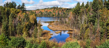 Rock Lake In Autumn Stock Images