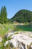 Rock and lake at Gosau, Austria. In summer Royalty Free Stock Photo