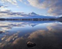 Rock in Lake Kawaguchi with Fuji Mountain in The Morning stock photo