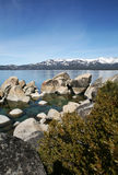 Rock, Lake, and Mountain Landscape stock image