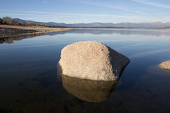 Rock on the lake Stock Images