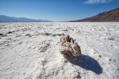 Rock in the lake of salt in death valley Stock Images