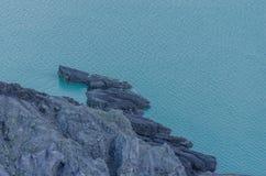rock in lake of volcano Stock Image