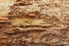 Rock, layeres structure, warm brown, yellow, red shades stock image