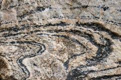 Rock Layers. Full frame Photo of The Swirled Layers in a Rock Royalty Free Stock Photo