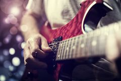 A rock lead guitarist in action on stage. A rock lead guitarist playing electric guitar in action on stage Stock Image