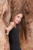 Rock ledge Girl Stock Images