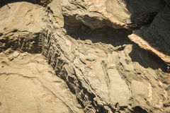 Rock ledges on the beach, Andros, Greece Stock Image