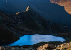 Rock in the light of sunset and mountain lake. Caucasus mountain Stock Photo