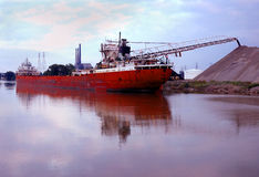Rock Limestone Ship. Bulk limestone at Local Detroit distributor, off loading Royalty Free Stock Photography