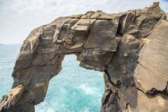 The rock looks like an elephant called `Trunk Rock`. A Famous Destination for Canoeing Activity, At the North Coast of Taiwan. Shenao, New Taipei, Taiwan royalty free stock images
