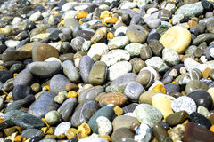 Rock. A lot of small stones on the seashore Stock Photos