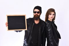 Rock lovers with confident faces. Girl and bearded man royalty free stock photos
