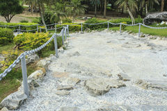 Rock-made path, Pavement made of stones in cement stock photos